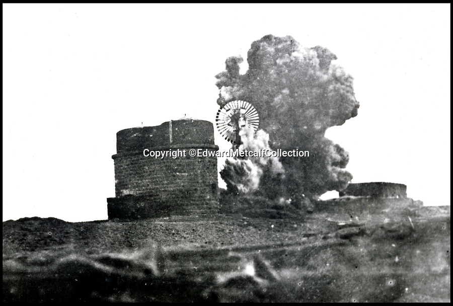Bournemouth News (01202 558833)<br /> Pic: EdwardMetcalfCollection/BNPS<br /> <br /> The water tower and windmill pump being blown up at Mudowarra by Captain Scott-Higgins.<br /> <br /> Fascinating never before seen photos of the Arab Revolt have revealed Lawrence of Arabia actually had help from a plucky band of British troops as well as the Arab tribesmen.<br /> <br /> A new book reveals the legendary campaign, that did much to shape the modern map of the Middle East, used cutting edge weapons like Rolls Royce armoured car's and British crewed aircraft to attack the Turkish enemy alongside the native arab army.<br /> <br /> The photos feature in military historian James Stejskal's new book Masters of Mayhem which sheds new light on T.E Lawrence's achievements fighting alongside Arab guerrilla forces in the Middle East during the First World War.<br /> <br /> They had been tucked away in the private photo albums of the descendants of soldiers who fought alongside Lawrence during the campaign.<br /> <br /> One historically important photo shows Lawrence and his driver sitting in a Rolls Royce in Marjeh Square in Damascus after it was captured in October 1918.<br /> <br /> Another documents the dramatic moment a water tower and windmill pump are blown up in the desert.