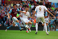 Saturday 15 September 2012<br /> Pictured: Itay Shechter of Swansea (C) is challenged by Ciaran Clark of Aston Villa (L).<br /> Re: Barclay's Premier League, Aston Villa v Swansea City FC at Villa Park, West Midlands, UK.