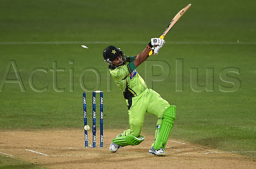 03.02.2015. Napier, New Zealand.  Umar Akmal is bowled during Match 2 of the ANZ One Day International Cricket Series between New Zealand Black Caps and Pakistan at McLean Park in Napier, New Zealand.