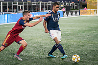FOXBOROUGH, MA - SEPTEMBER 21: Brandon Bye #15 of New England Revolution passes the ball as Brooks Lennon #12 of Real Salt Lake during a game between Real Salt Lake and New England Revolution at Gillette Stadium on September 21, 2019 in Foxborough, Massachusetts.