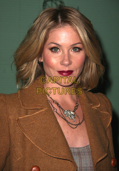 """CHRISTINA APPLEGATE .Academy Of Television Arts and Sciences Presents An Evening With """"Samantha Who?"""" held at the Leonard H. Goldenson Theatre, North Hollywood, California, USA, 12th February 2009. .portrait headshot red lipstick necklace brown tweed coat grey gray plaid tartan checked.CAP/ADM/CH.©Charles Harris/AdMedia/Capital Pictures"""
