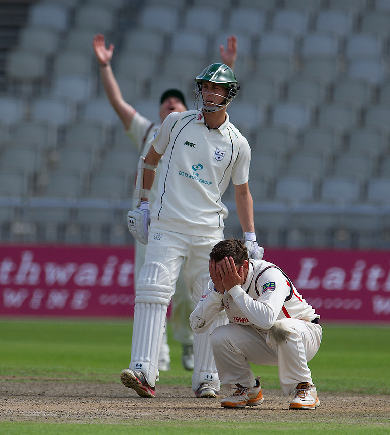 Lancashire's Simon Kerrigan just miises out on a bowling hat-terick..County Cricket - Liverpool Victoria County Championship - Division One - Lancashire v Worcestershire - Day 1 - Wednesday 18th July 2012 - Old Trafford - Manchester..