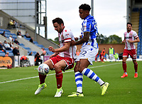 Stevenage's Chris Whelpdale battles with Colchester United's Cole Kpekawa<br /> <br /> Photographer Hannah Fountain/CameraSport<br /> <br /> The EFL Sky Bet League Two - Colchester United v Stevenage Borough - Saturday August 12th 2017 - Colchester Community Stadium - Colchester<br /> <br /> World Copyright &copy; 2017 CameraSport. All rights reserved. 43 Linden Ave. Countesthorpe. Leicester. England. LE8 5PG - Tel: +44 (0) 116 277 4147 - admin@camerasport.com - www.camerasport.com