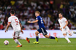 Doan Ritsu of Japan (C) fights for the ball with Milad Mohammadikeshmarzi of Iran (L) during the AFC Asian Cup UAE 2019 Semi Finals match between I.R. Iran (IRN) and Japan (JPN) at Hazza Bin Zayed Stadium  on 28 January 2019 in Al Alin, United Arab Emirates. Photo by Marcio Rodrigo Machado / Power Sport Images