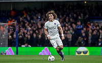 David Luiz of Paris Saint-Germain on the ball during the UEFA Champions League Round of 16 2nd leg match between Chelsea and PSG at Stamford Bridge, London, England on 9 March 2016. Photo by Andy Rowland.