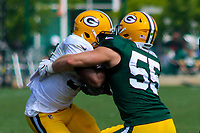 Green Bay Packers running back Aaron Jones (33) and linebacker Cody Heiman (55) during a training camp practice on August 29, 2017 at Ray Nitschke Field in Green Bay, Wisconsin.   (Brad Krause/Krause Sports Photography)