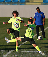 David Luiz of Brazil and Hernanes of Brazil in action during training ahead of tomorrow's World Cup quarter final vs Colombia