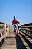 Girl learning to ride a bike.