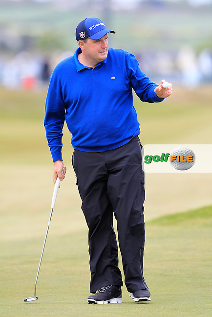 Anthony Wall (ENG) sinks his putt on the 18th green during Saturday's Round 3 of the 2015 Dubai Duty Free Irish Open, Royal County Down Golf Club, Newcastle Co Down, Northern Ireland 5/30/2015<br /> Picture Eoin Clarke, www.golffile.ie