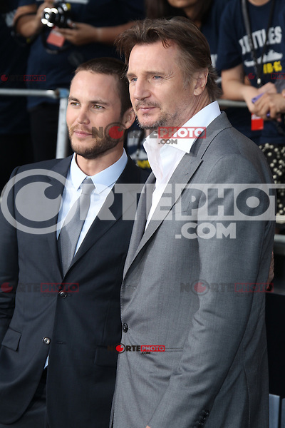 Taylor Kitsch and Liam Neeson at the film premiere of 'Battleship,' at the NOKIA Theatre at L.A. LIVE in Los Angeles, California. May, 10, 2012. © mpi20/MediaPunch Inc.