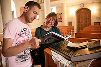 A visitor and a member of church personnel at the Mor Petrus Mor Paulus Church, Adiyaman, southeastern Turkey