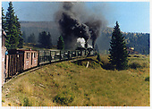 3/4 view from back of 2 engines hauling freight over Cumbres Pass.<br /> C&amp;TS  Cumbres Pass, CO