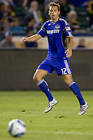 Kansas City Wizards midfielder Jimmy Conrad dances around the ball.  The Kansas City Wizards beat the LA Galaxy 2-0 at Home Depot Center stadium in Carson, California on Saturday August 28, 2010.