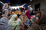 "The Langar is an essential part of Sikh practice, as it is a great leveller, where everyone sits together and eats, and people from all walks of life together prepare and serve the food. According to National Geographic's ""MegaKitchens"" food is prepared for about five million people in all the Langars during Hola Mohalla."