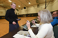 NWA Democrat-Gazette/FLIP PUTTHOFF <br /> Esther Seim (left) of Bentonville checks in to vote Tuesday March 12 2019 with poll worker Shirley Jordan during the sales tax election to fund a new Benton County courthouse and upgrades to the existing courthouse. Seim voted at the Bentonville Church of Christ.