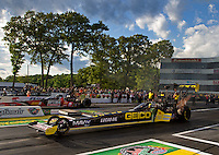 May 30, 2014; Englishtown, NJ, USA; NHRA top fuel driver Richie Crampton (near lane) races alongside J.R. Todd during qualifying for the Summernationals at Raceway Park. Mandatory Credit: Mark J. Rebilas-