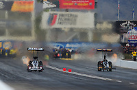 Feb. 19, 2012; Chandler, AZ, USA; NHRA top fuel dragster driver Shawn Langdon (left) races alongside Troy Buff during the Arizona Nationals at Firebird International Raceway. Mandatory Credit: Mark J. Rebilas-