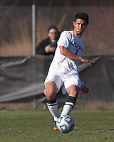 University of Connecticut defender Michael Mercado (3) clears the ball. .NCAA Tournament. University of Connecticut (white) defeated Northeastern University (black), 1-0, at Morrone Stadium at University of Connecticut on November 18, 2012.