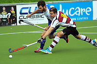 Johnny Kinder (left) and Warren Wild compete for the ball during the 2017 National Hockey League Men's final between Auckland and North Harbour at National Hockey Stadium in Wellington, New Zealand on Sunday, 24 September 2017. Photo: Dave Lintott / lintottphoto.co.nz