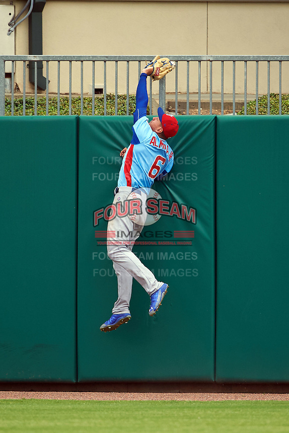 Tennessee Smokies outfielder Albert Almora (6) jumps at the wall having the ball go off the top of his glove while attempting to catch a home run during a game against the Montgomery Biscuits on May 25, 2015 at Riverwalk Stadium in Montgomery, Alabama.  Tennessee defeated Montgomery 6-3 as the game was called after eight innings due to rain.  (Mike Janes/Four Seam Images)