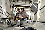 Stephen Quigg, a United Methodist missionary, installing an emergency location transmitter in a plane belonging to Wings of Caring Aviation in Kananga, Congo. The program is sponsored by the United Methodist Church. The Kananga-based pilot is Jacques Umembudi Akasa.