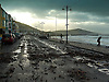 Aberystwyth Promenade strewn with debris after winter storms which caused floods and damage to roads,cars and buildings.<br />
