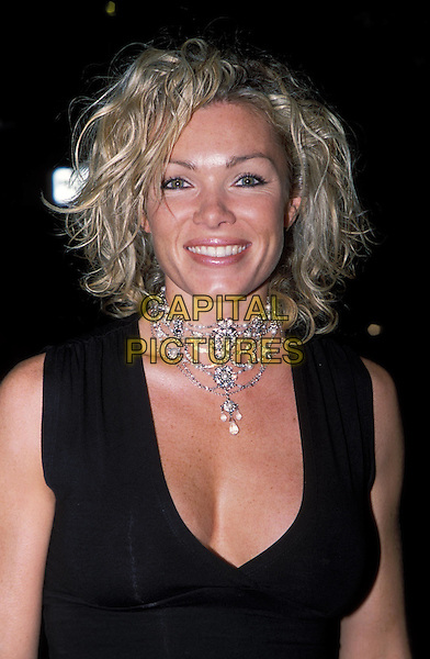 NELL McANDREW.Sports Illustrated Swimsuit Issue 2003 - Launch Party at The Collection.www.capitalpictures.com.sales@capitalpictures.com.© Capital Pictures.choker necklace, plunging neckline.