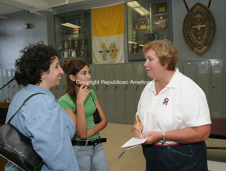 WATERBURY,  CT 28 August 2005 -082805BZ03- From left-  Kim Larsen, and her daughter Brianna Larsen, 13, talk with principal Jackie Jennings<br /> during a welcome picnic for incoming freshman students at Sacred Heart High School Sunday afternoon. <br /> Jamison C. Bazinet / Republican-American