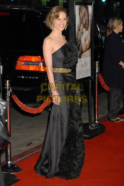 "HILARY SWANK .""P.S. I Love You"" Los Angeles Premiere at Grauman's Chinese Theatre, Hollywood, California, USA,.9 December 2007..full length strapless black dress ruffle front gold belt waistband.CAP/ADM/BP.©Byron Purvis/AdMedia/Capital Pictures."