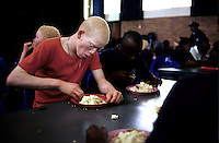 KLIPRIVER, SOUTH AFRICA APRIL 16: Abel Cindi, age 19, and Sibongiseni Dlamini, age 19 eats lunch on April 15, 2003 at Sibonile (means: we have seen) School for the Blind in Klipriver, south of Johannesburg, South Africa. A blind woman founded the school in 1994. The school has about 125 students from disadvantaged communities around South Africa. Many of the children have faced rejection from their families and communities, and at Sibonile they have a chance for a good education. .(Photo: Per-Anders Pettersson)..