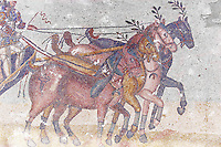 Chariot racing at the Circus Maximus. Roman mosaics at the Villa Romana del Casale which containis the richest, largest and most complex collection of Roman mosaics in the world. Constructed in the first quarter of the 4th century AD. Sicily, Italy. A UNESCO World Heritage Site.