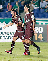 CALI - COLOMBIA - 13-03-2014: Lautaro Acosta (Izq.) jugador del Lanus de Argentina, celebra el gol notado durante partido entre Deportivo Cali y Lanus de la segunda fase, grupo 3, de la Copa Bridgestone Libertadores en el estadio Pascual Guerrero, de la ciudad de Cali. / Lautaro Acosta (L)  player of Lanus of Argentina, celebrates a goal scored during a match between Deportivo Cali and Lanus for the second phase, group 3, of the Copa Bridgestone Libertadores in the Pascual Guerrero stadium in Cali city. Photo: VizzorImage / Juan C. Quintero / Str.