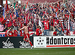 FC Dallas forward Kenny Cooper (33) celebrates after scoring a goal during the game between the FC Dallas and the Houston Dynamo at the FC Dallas Stadium in Frisco,Texas.