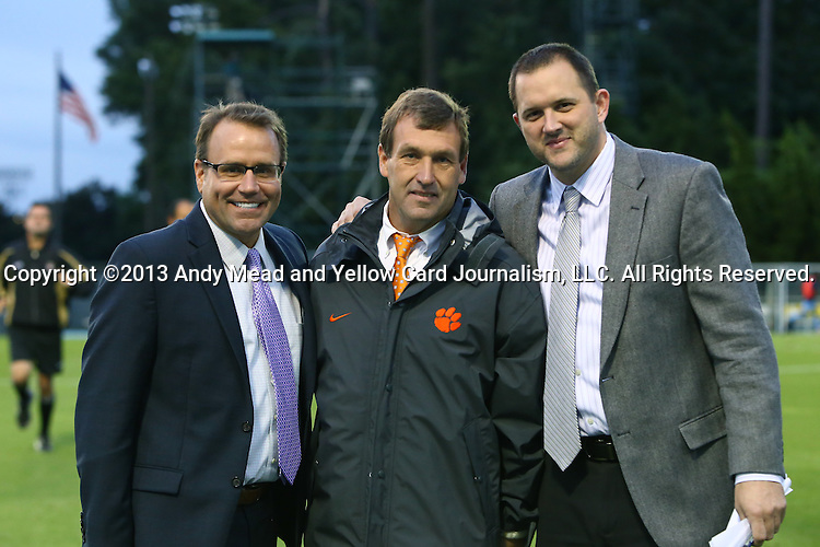 08 October 2013: Clemson head coach Mike Noonan (center) with ESPN broadcasters Dean Linke (left) and John Bouille (right). The University of North Carolina Tar Heels hosted the Clemson University Tigers at Fetzer Field in Chapel Hill, NC in a 2013 NCAA Division I Men's Soccer match. Clemson won the game 2-1 in overtime.
