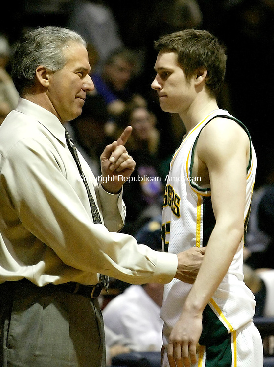 MERIDEN, CT. 14 MARCH 2006- 031406BZ12- Holy Cross High head coach Ed Generali talks with Michael Chere (15) in the final minutes of the Division II semifinals against Career High at Platt High School in Meriden Tuesday night.  <br /> Jamison C. Bazinet Republican-American