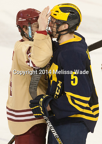 Teddy Doherty (BC - 4), Michael Downing (Michigan - 5) - The Boston College Eagles defeated the visiting University of Michigan Wolverines 5-1 (EN) on Saturday, December 13, 2014, at Kelley Rink in Conte Forum in Chestnut Hill, Massachusetts.