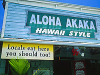 Signs invite one and all to come and enjoy local food at its best. Hawaiian style. This restaurant on the Big Isle.
