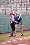 A coach and player during Little League District Championship.