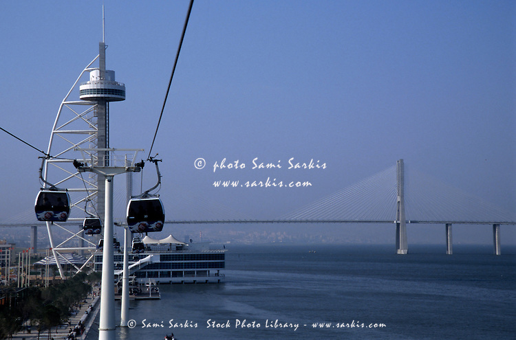 Cable cars at Expo 98 with Vasco da Gama Bridge on Rio Tejo, Lisbon, Portugal.