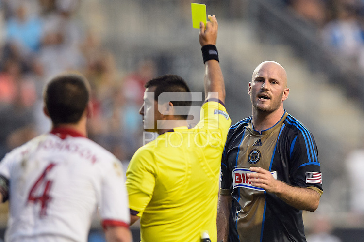 Conor Casey (6) of the Philadelphia Union reacts to getting a yellow card from referee Ricardo Salazar during a Major League Soccer (MLS) match against the Portland Timbers at PPL Park in Chester, PA, on July 20, 2013.