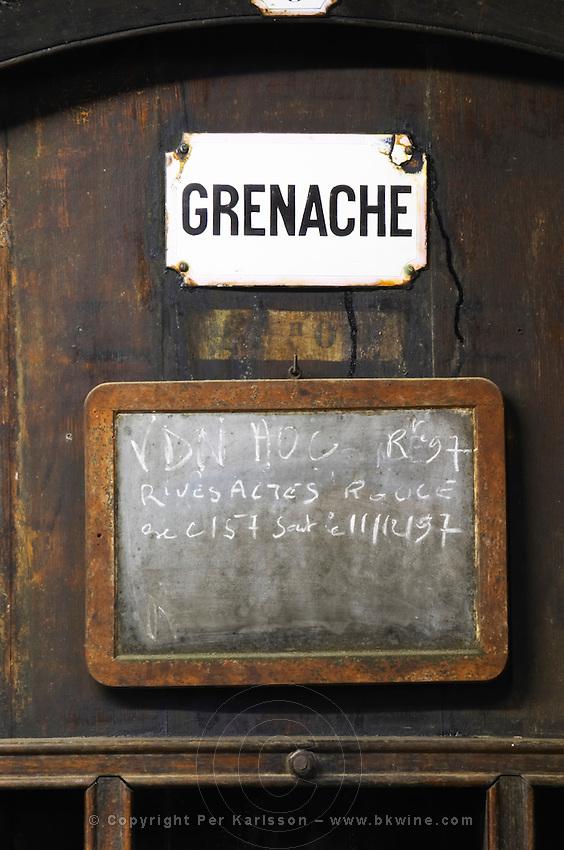Grenache, VDN Vin Doux Naturel, R Rouge Red 1997, Rivesaltes. Chateau de Nouvelles. Fitou. Languedoc. Barrel cellar. Wooden fermentation and storage tanks. France. Europe.
