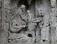Joseph holds the baby Jesus whilst a priest circumcises him in the temple. The circumcision of Christ, by Jean Soulas, upper scene from the choir screen, 1519-25, Chartres Cathedral, Eure-et-Loir, France. These sculpted scenes show the change in style from Gothic to Renaissance in the early 16th century in France. Chartres cathedral was built 1194-1250 and is a fine example of Gothic architecture. It was declared a UNESCO World Heritage Site in 1979. Picture by Manuel Cohen.