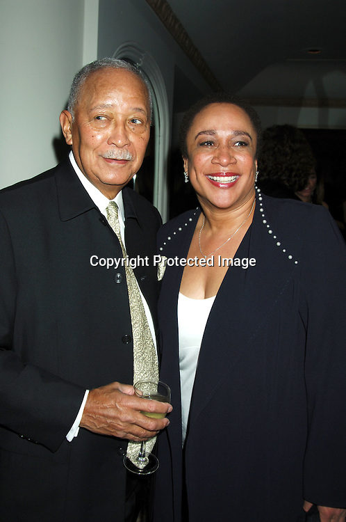 Former New York City Mayor David Dinkins and S Epatha Merkerson ..at the 58th Annual Writer's Guild Awards Ceremony ..on February 4, 2006 at the Starlight Roof at The Waldorf ..Astoria Hotel. ..Photo by Robin Platzer, Twin Images