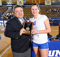22 November 2008:  Sun Belt Conference Associate Commissioner Rick Mello presents one of the All Conference Team awards after the WKU 3-0 victory over New Orleans in the championship game of the Sun Belt Conference tournament at U.S. Century Bank Arena in Miami, Florida.