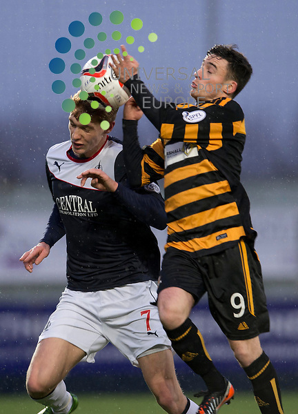 Jay Fulton of Falkirk challenges for the ball against Kevin Cawley of Alloa during the Scottish Championship match between Falkirk and Alloa at The Falkirk Stadium, Falkirk. 28 December 2013. Picture by Ian Sneddon / Universal News and Sport (Scotland). All pictures must be credited to www.universalnewsandsport.com. (Office) 0844 884 51 22.