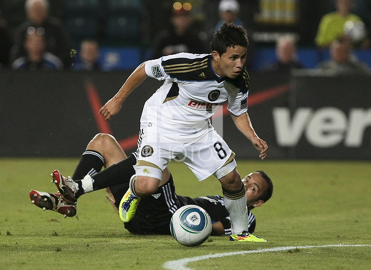 Roger Torres (8) dribbles past Ramiro Corrales (12). The San Jose Earthquakes tied the Philadelphia Union 0-0 at Buck Shaw Stadium in Santa Clara, California on July 9th, 2011.