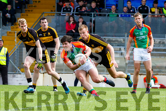 Mike Breen Mid Kerry and Fionn Fitzgerald Dr Crokes contest the loose ball during their SFC clash in Fitzgerald Stadium on Sunday