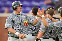 Cameron Walter #37 of the VMI Keydets high fives teammates after scoring a run against the High Point Panthers at Willard Stadium on March 30, 2012 in High Point, North Carolina.  The Panthers defeated the Keydets 11-3.  (Brian Westerholt/Four Seam Images)