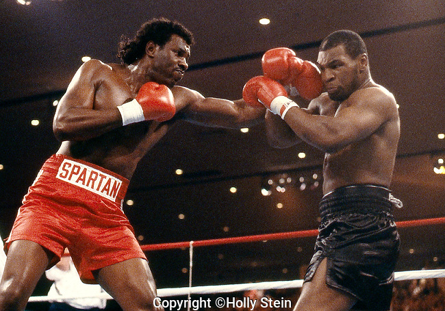 Mike Tyson v. Tony Tucker.  Tyson UD 12rds.  WBC heavyweight title, WBA World heavyweight title, IBF heavyweight title.