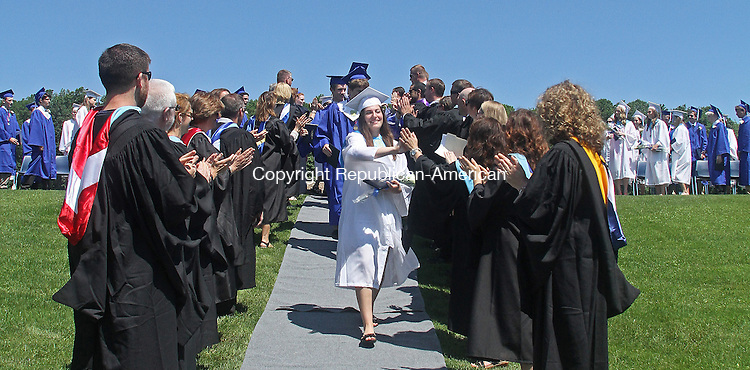 Washington, CT-061513MK03 Class president and valedictorian Emily Deanne leads her fellow graduates in the recessional after the Shepaug Valley High School class of 2013 commencement exercises on Saturday morning at Shepaug Valley high School in Washington. Michael Kabelka / Republican-American
